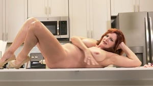 Redhead Andi James teasing porno in HD
